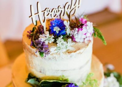 Semi naked cake at Tipi garden wedding Hampshire, coordinated by Wild Wedding Company
