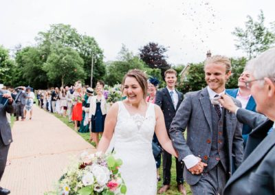 Emma and Zac confetti shot at their Hampshire Tipi Wedding