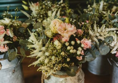 urns-flowers-marquee-wedding-rustic